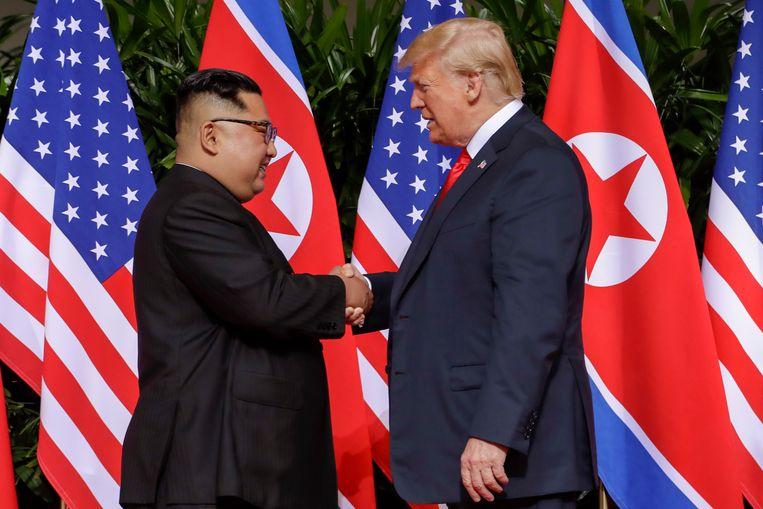 President Donald Trump en staatshoofd Kim Jong Un in Singapore.  Beeld AP