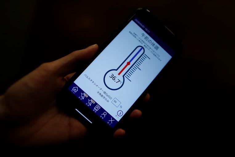 Een app die in Japan wordt gebruikt om het werk van zorgmedewerkers te verlichten.  Beeld REUTERS