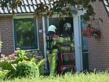 Bewoonster Raalte ziet in tuin rook uit haar huis komen