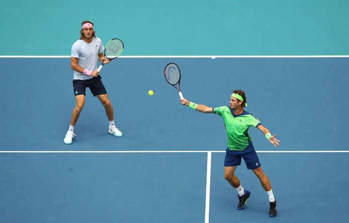 Wesley Koolhof (groen) en Stefanos Tsitsipas.