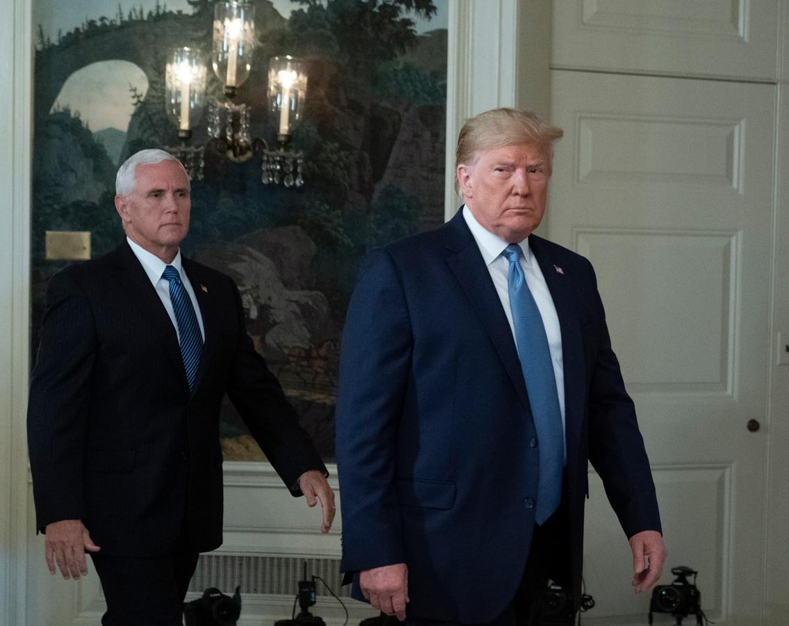 Pence (links) en Trump.