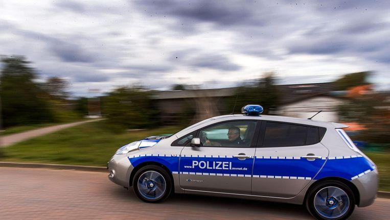 Een Duitse politiewagen. Deze foto dient ter illustratie, de persoon in de auto noch deze auto zelf komt in dit verhaal voor. Beeld epa