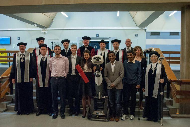 Promotie met robot als paranimf op de TU Delft. Beeld TU Delft