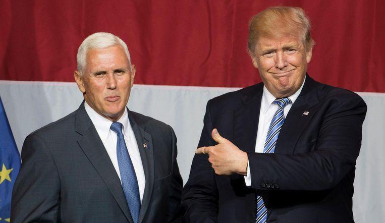 Mike Pence (L) en Donald Trump (R). Beeld afp