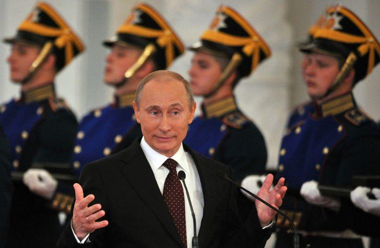 President Poetin woont intussen een ceremonie bij ter viering van 'Ruslanddag', een feestdag waarmee de onafhankelijkheid van Rusland na de val van de Soviet-Unie in 1990 herdacht wordt. Beeld afp