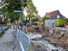 Waterpomp aan in Hapert: schade aan straat en stoep