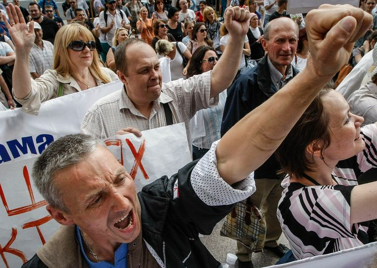 Betogers nemen deel aan een anti-holebimars in Kiev, in 2013.