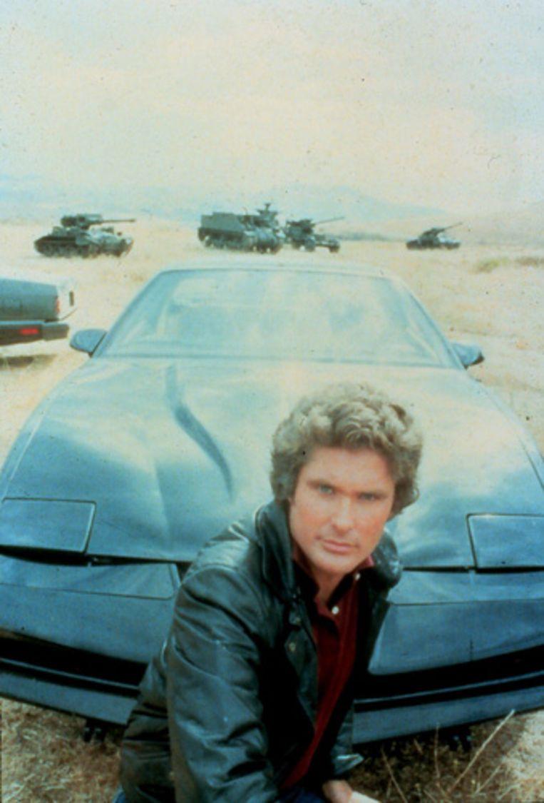 Foto van David Hasselhoff als Michael Knight in de oorspronkelijke Knight Rider-serie uit de jaren tachtig, met achter hem de sprekende auto KITT. (Kippa) Beeld