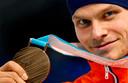 Verweij in 2018 met de bronzen medaille op de massastart in Pyeongchang.