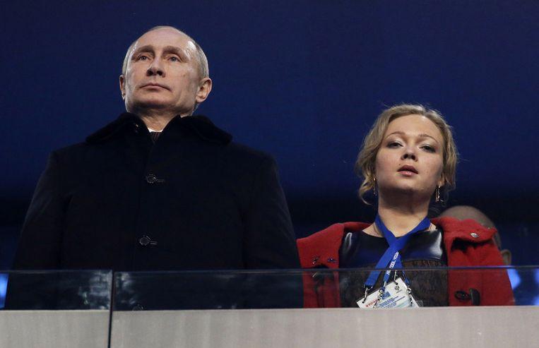 De Russische premier Vladimir Poetin en Irina Skvortsova. Beeld ap