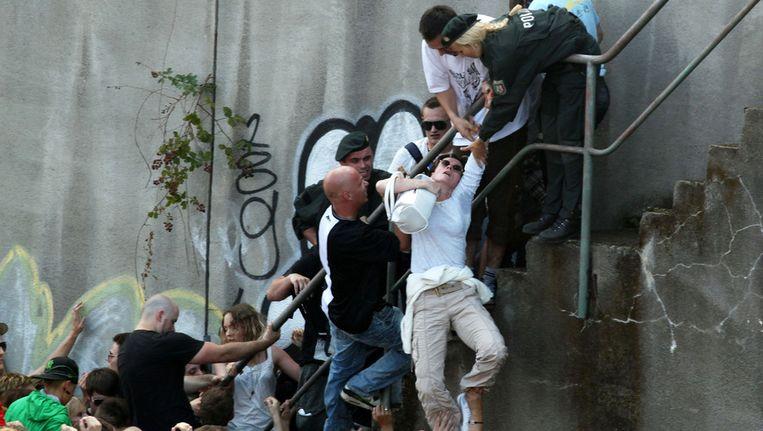 Paniek tijdens de Loveparade in Duisburg vorig jaar. © ANP Beeld