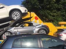 Politie stuit in Drunen op loods vol gestolen splinternieuwe auto's