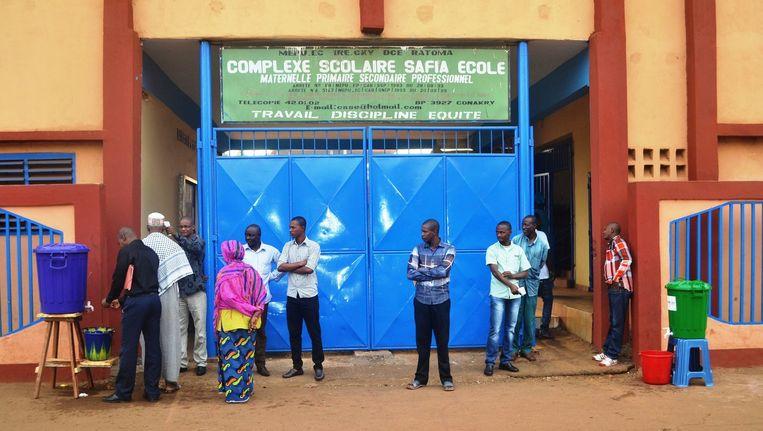 In Guinee zijn de scholen deze week weer opengegaan. Beeld Cellou Binani / AFP