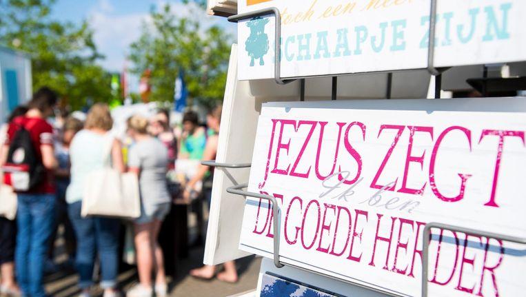 Bezoekers tijdens de viering van de 42ste EO-Jongerendag in het GelreDome. Beeld anp