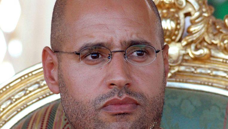 Portret van Seif al-Islam Kadaffi, een van zoons van de Libische leider Muammar Kadaffi. Beeld AFP