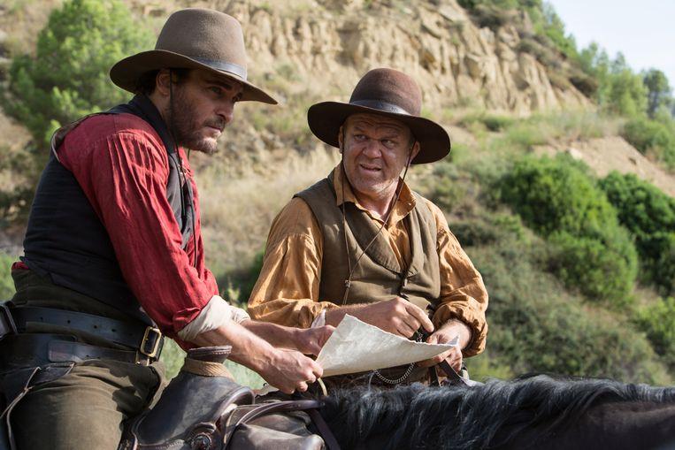Joaquin Phoenix (links) en John C. Reilly als The Sisters Brothers. Beeld