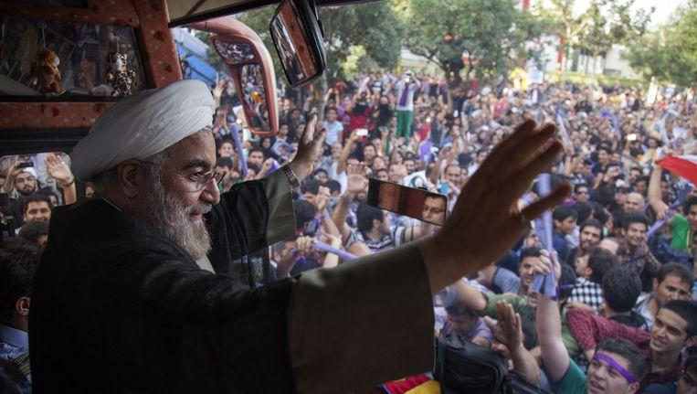 De Iraanse president Rohani tijdens een campagnetoer in Mashhad. Beeld getty