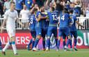 Blijdschap bij de spelers van Kosovo.