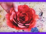 Zo knutsel je van de bladzijdes van een boek een mooie roos
