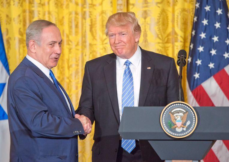President Donald Trump en premier Benjamin Netanyahu spraken warm over elkaar tijdens een gezamenlijke persconferentie in het Witte Huis. Beeld Photo News