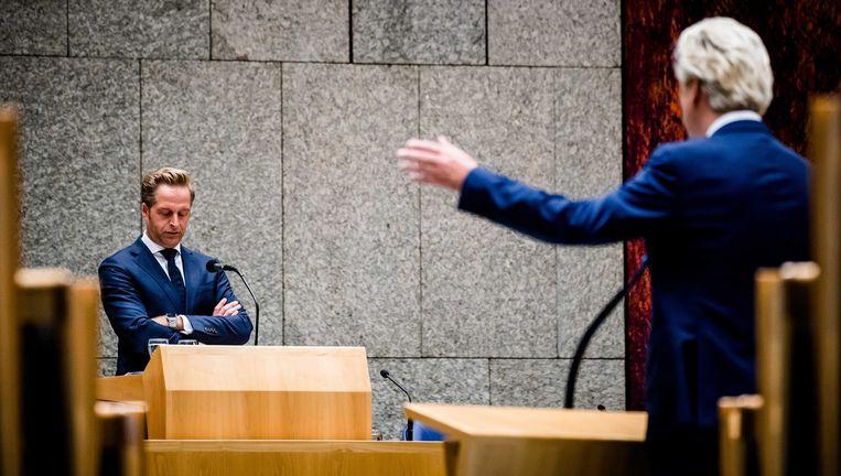 Minister Hugo de Jonge van Volksgezondheid en Geert Wilders (PVV) tijdens het Tweede Kamerdebat over het coronavirus deze week. Beeld Bart Maat/ANP