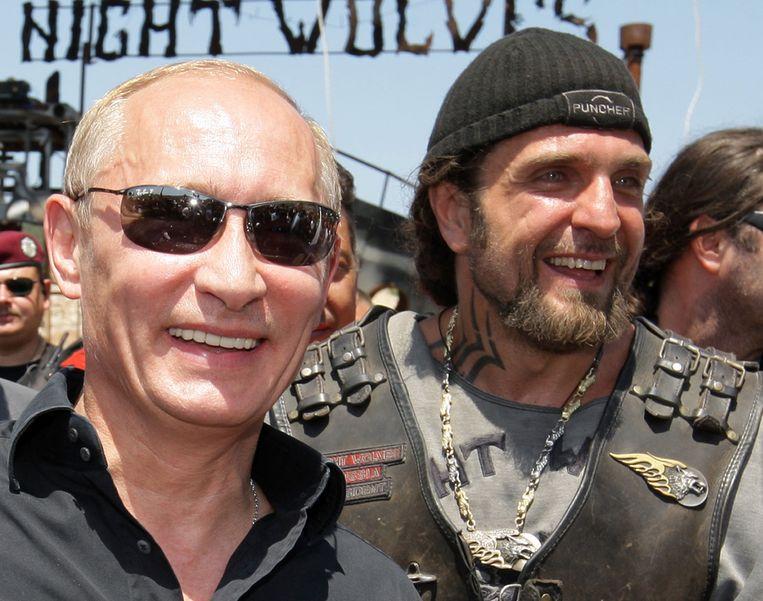 Poetin en Zaldostanov, archiefbeeld uit 2010. Beeld AFP