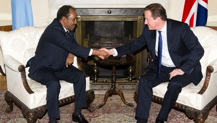 De Britse premier Cameron (rechts) ontving vandaag de Somalische president Hassan Sheikh Mohamud. Beeld epa