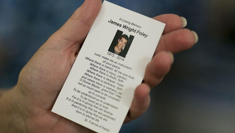 Een herdenkingskaart voor de Amerikaanse fotojournalist James Foley die vorige week werd vermoord door IS. Beeld AFP