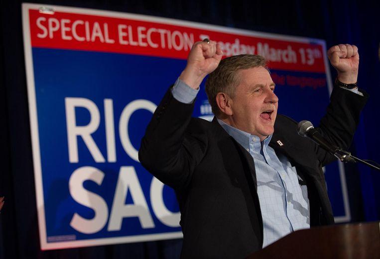 De Republikein Rick Saccone tijdens een verkiezingsbijeenkomst in een golfclub. Beeld AFP