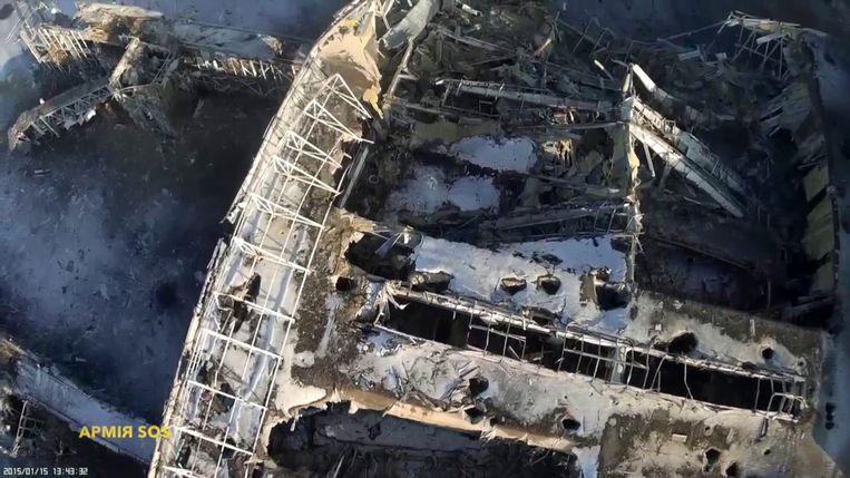 De vernietigde terminal van het vliegveld van Donetsk. Beeld REUTERS