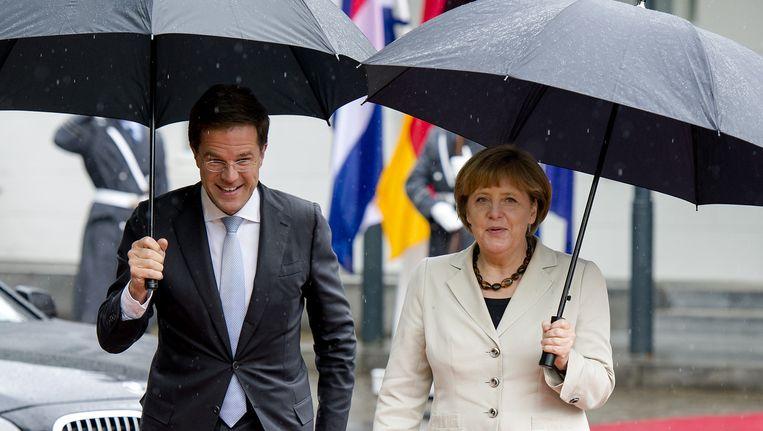 Het Duitsland van Angela Merkel zou zonder de eurocrisis een begrotingstekort hebben in plaats van een overschot Beeld ANP