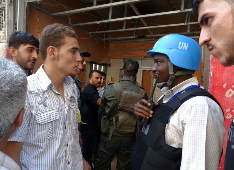 Wapeninspecteurs van de VN aan het werk in Damascus. Beeld afp