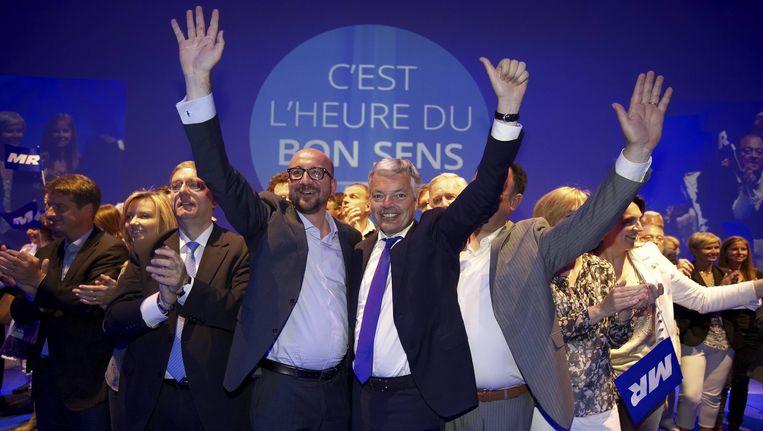 Partijvoorzitter Charles Michel en buitenlandminister Didier Reynders op de slotmeeting in Brussel.