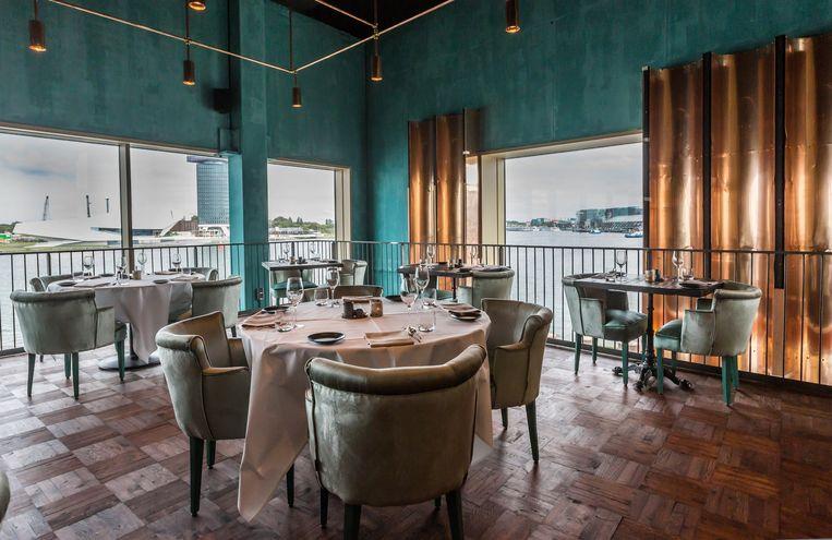 'Paris meets Marrakech,' zegt mede-eigenaar Henry Pattiwael van Westerloo over de mediterraanse en industriële elementen in het restaurant. Beeld Eva Plevier