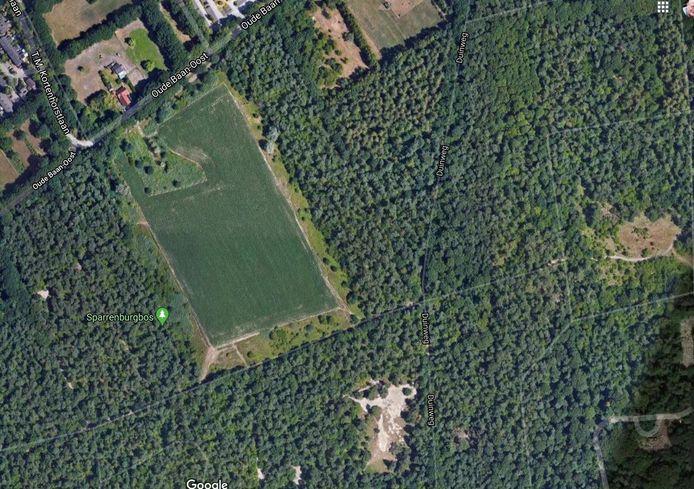 Luchtfoto van een deel van het Sparrenburgbos. De grote groene vlek is de voormalige vuilstort.