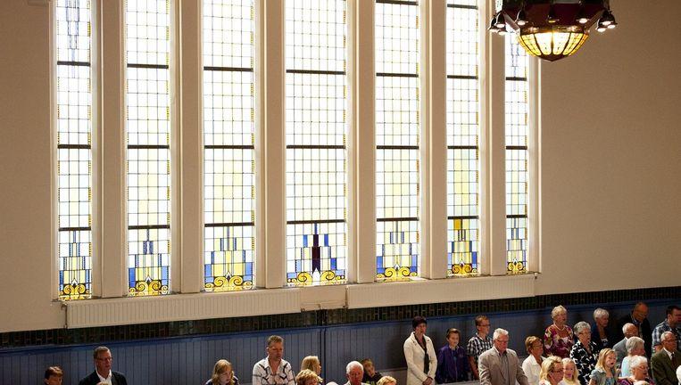 Leden van de PKN in de kerk. Beeld Anp