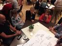 Jeroen Mutsaers (links) neemt deel aan een dialoog over het asielzoekerscentrum in Oisterwijk