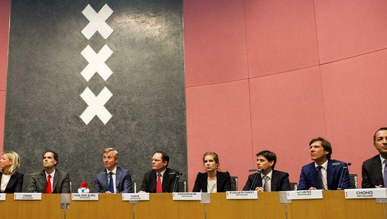 De wethouders uit het in 2014 aangetreden college. Vanaf links: Ollongren, Ivens, Van der Burg, Kock, Kukenheim, Vliegenthart, Litjens en Choho. Beeld anp