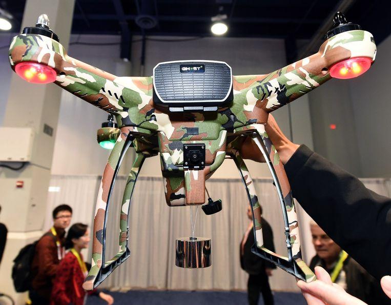 Een drone in camouflagekleuren. Beeld afp