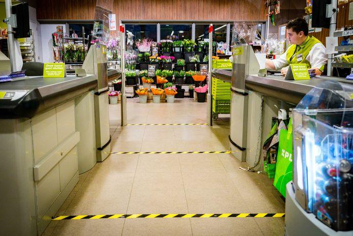 Maatregelen tegen het coronavirus in een supermarkt van Plus. Foto ter illustratie.