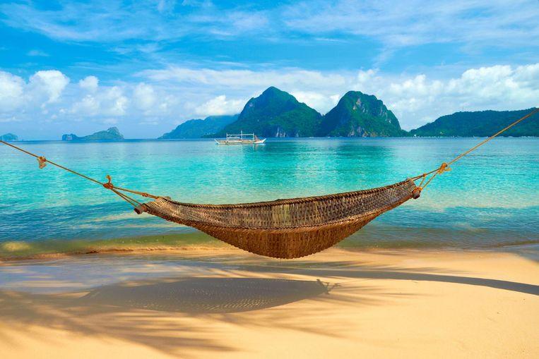 Hangmat in en genieten van het blauwe water op Palawan.