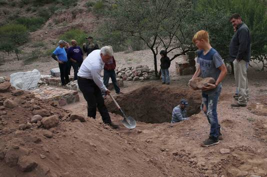 Men dig a mass grave for some of the women and children related to the extended LeBaron family who were killed by drug cartel gunmen, before their burial at a family cemetery in La Mora, Sonora state, Mexico, Thursday, Nov. 7, 2019. Three women and six of their children were gunned down in an attack while traveling along Mexico's Chihuahua and Sonora state border on Monday. (AP Photo/Marco Ugarte)