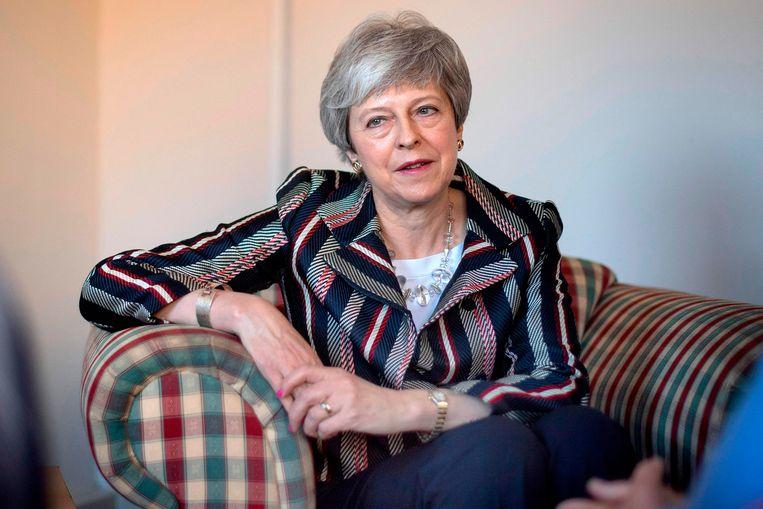 De Britse premier Theresa May tijdens een bijeenkomst voor een goed doel.   Beeld AFP