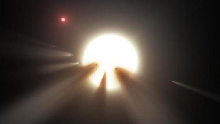 Artistiek concept van een ster achter een stukgeslagen komeet.