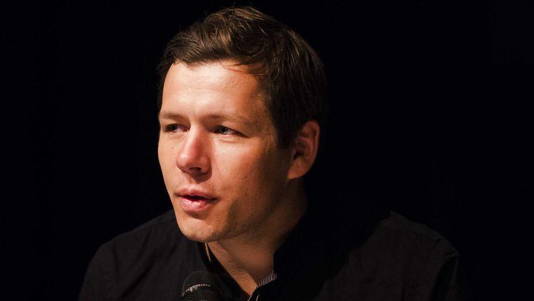 De Deense winnende fotograaf Mads Nissen geeft een persconferentie tijdens de bekendmaking van de World Press Photo 2014. Beeld anp