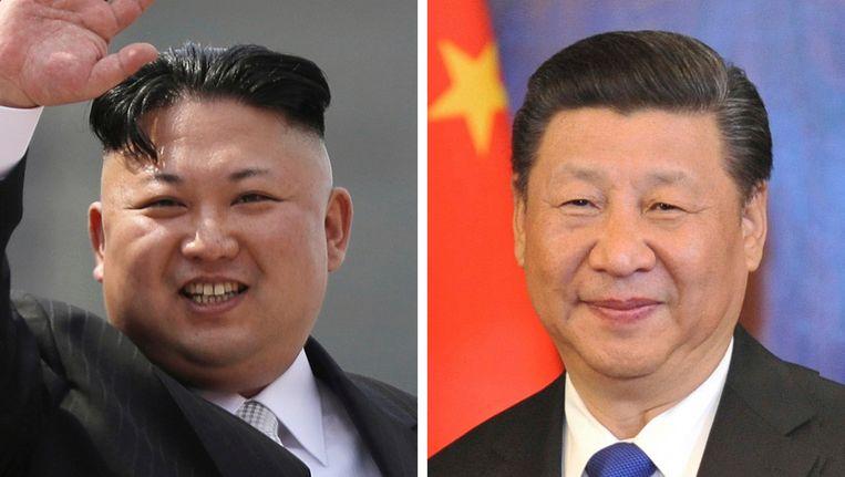 De Noord-Koreaanse leider Kim Jong-un (L), de Chinese president Xi Jinping (R).
