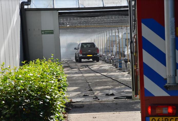 Auto in brand in caravanstalling Bavel.