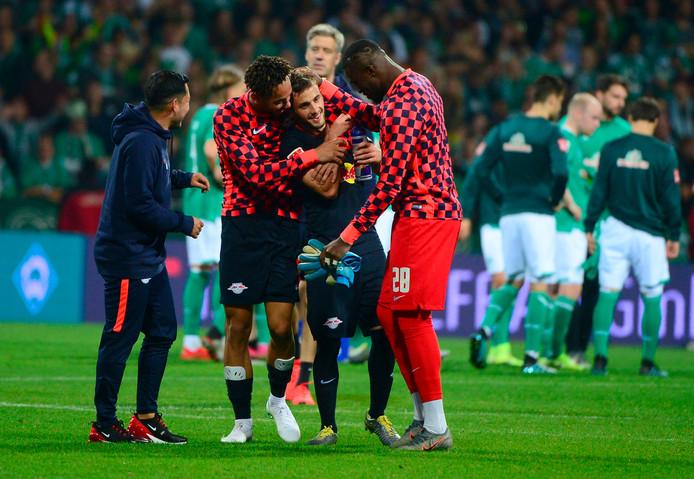 Spelers van Leipzig vieren de overwinning op Werder Bremen.