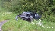 Auto schuift van afrit in Zolder