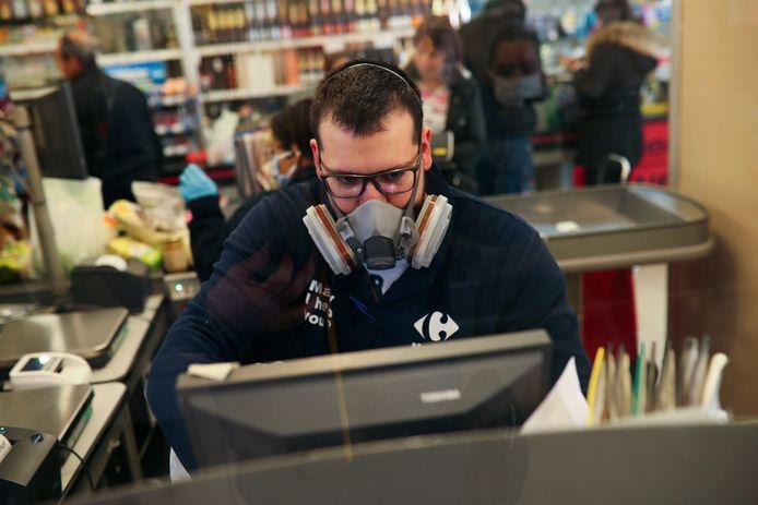 Un caissier de supermarché à Bruxelles. (Photo d'illustration)